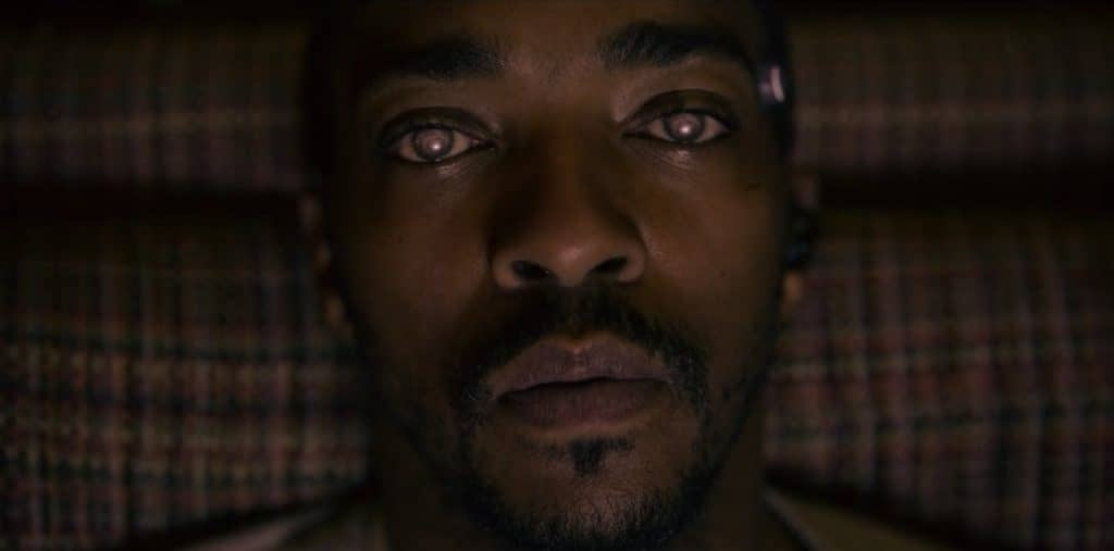 anthony mackie using the tckr systems virtual reality device in black mirror season 5 1 1024x507